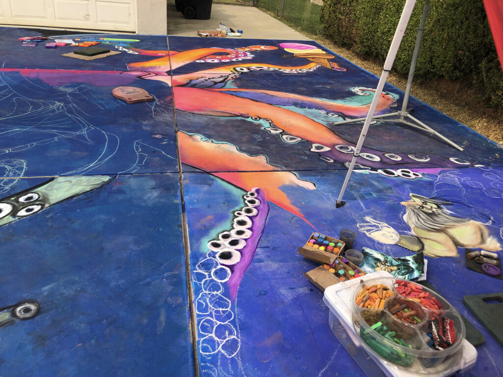 The bottom right tentacle was chalked by Monica Orozco Thaller, you can see her little Poseidon taking form in the kraken's tentacle.