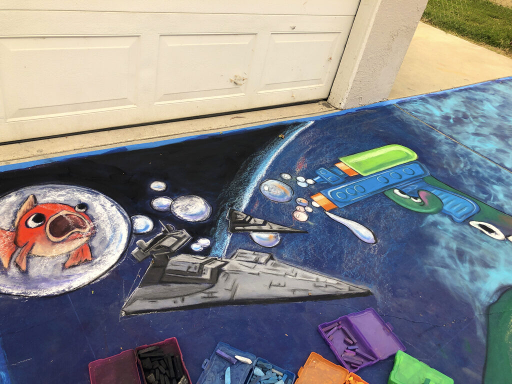 Lori Antointte's corner is coming along, with an outer space battle scene.
